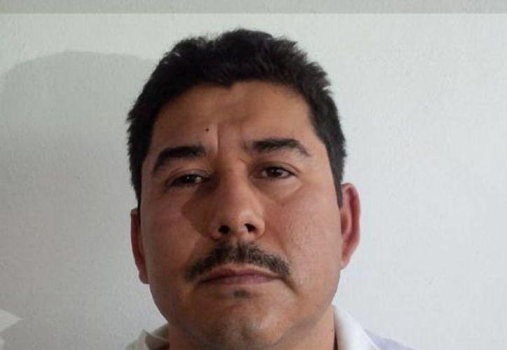 Carlos Hoo Ramírez fue detenido en posesión de armas largas y cientos de cartuchos al ser detenido. (Agencias)