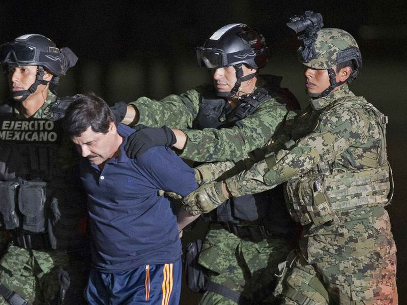 "Joaquin ""El Chapo"" Guzman, the head of Mexico's Sinaloa Cartel, being escorted to a helicopter in Mexico City following his capture overnight in the beach resort town of Mazatlan. The lawyer for Guzman says his client's mental health is deteriorating."