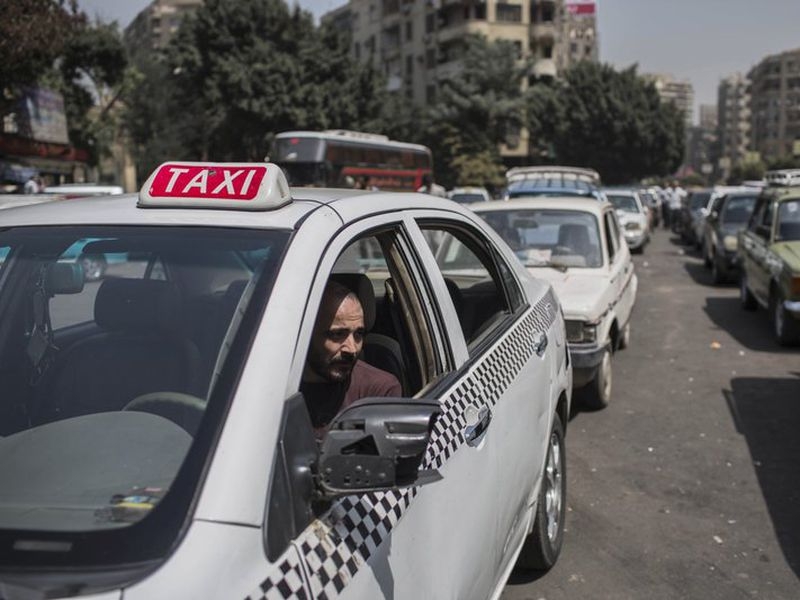 A taxi driver waits in line for fuel at a gas station in Cairo's. (AP)
