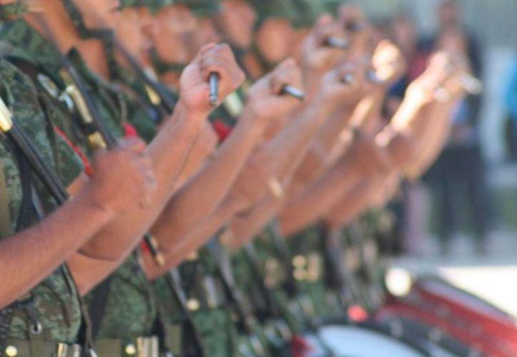 Militares del 102o. Batallón de Infantería tienen las manos 'machandas de sangre', según un reporte de la AP.  La imagen no es del cuerpo militar, es solo de contexto. (mediosuag.mx)