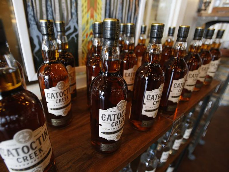 Catoctin Creek Distillery whiskey is on display in the tasting room in Purcellville, Va. The European Union on Friday started taxing a range of U.S.