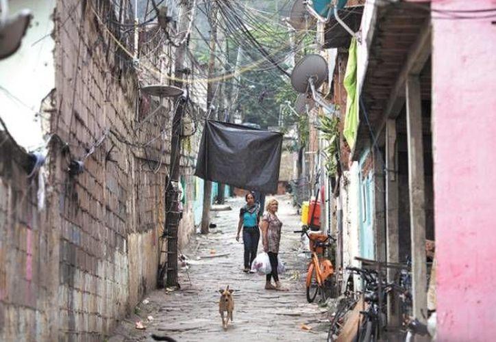 Las favelas, nombre que se le da en Brasil a sus particulares barrios humildes, es el hogar del seis por ciento de la población total en este país sudamericano. (Archivo AP)