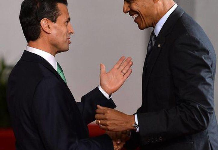 Peña Nieto y Obama designaron representantes para una reunión donde atenderán el tema de la migración infantil. En la imagen aparecen durante la pasada Cumbre de Líderes de América del Norte. (Archivo/Notimex)