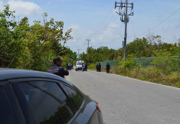 El cuerpo del joven hondureño hallado amordazado en Punta Sam, será reclamado por el consulado de Honduras. (Eric Galindo/SIPSE)