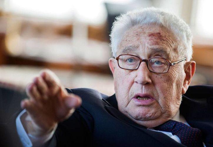 Foto de archivo del 11 de junio de 2013, del ex secretario de Estado Henry Kissinger durante una recepción por su cumpleaños 90 en Berlín, Alemania. (Foto AP/Gero Breloer, Pool)