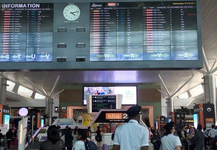 Imagen del Aeropuerto Internacional de Kuala Lumpur, Malasia, donde el norcoreano Kim Jong Nam fue asesinado. La mujer detenida asegura que fue engañada y pensó que participaba en un programa de cámara escondida. (AP Photo/Margie Mason)