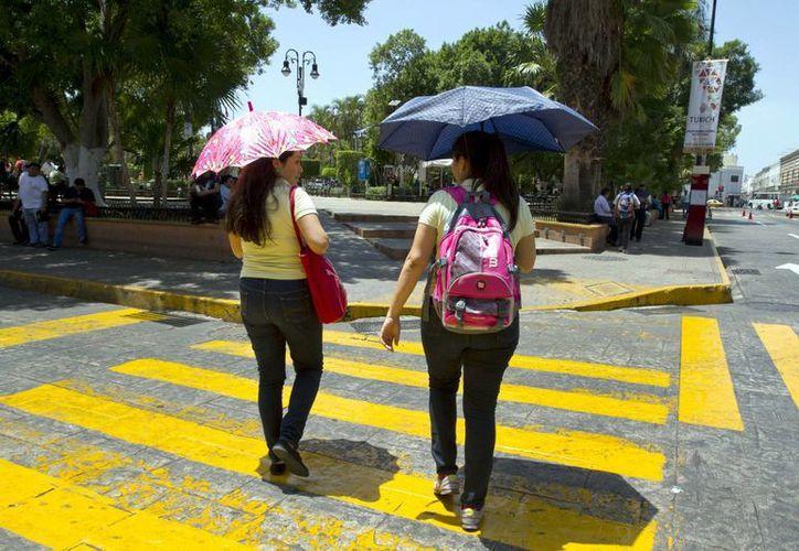 A pesar de las altas temperaturas que prevalecen, hay probabilidades de que llueva en Yucatán este lunes. (Archivo/Notimex)