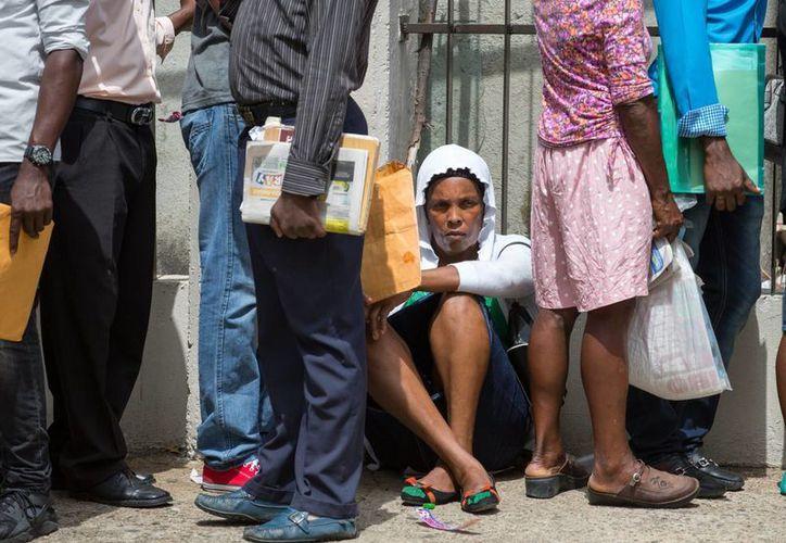 El gobierno de República Dominicana ofrece traslado y mudanzas a los miles de indocumentados que están en el país de manera irregular. (EFE)
