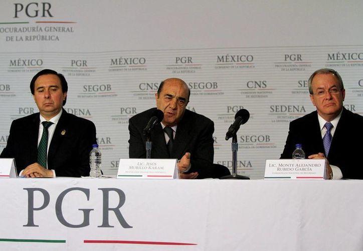 Jesús Murillo Karam rechazó versiones de la desaparición de peritos extranjeros que analizan los restos hallados en fosas clandestinas de Iguala. (Notimex)