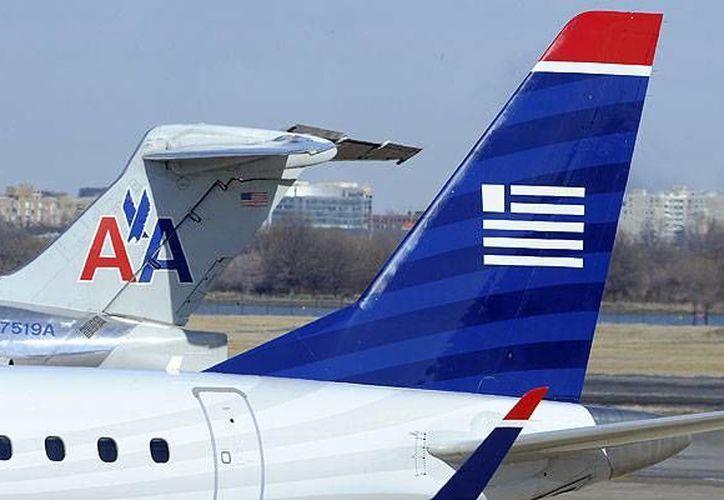 El Departamento de Justicia y seis estados interpusieron hoy una demanda contra la fusión de las aerolíneas American Airlines y US Airways. (Archivo/Reuters)