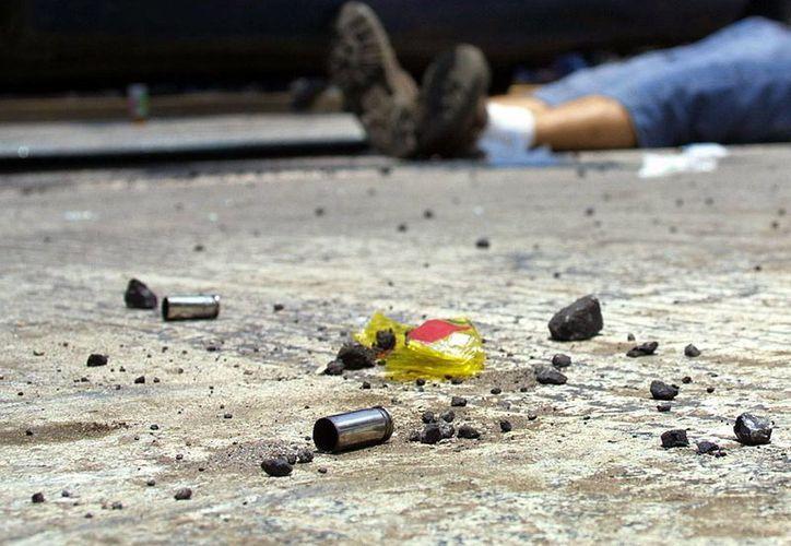 Hombres encapuchados asesinaron a 11 integrantes de una misma familia en la localidad de San José El Mirador, en el municipio de Coxcatlán, Puebla. (imagen de contexto/caraotadigital.com)