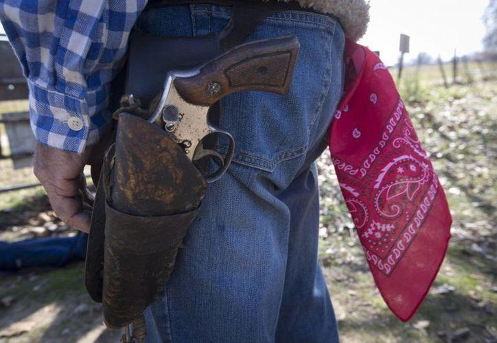 """Desde el 1 de enero, casi mil personas están autorizadas a portar consigo armas en forma abierta, """"como en el viejo Oeste"""". Imagen de contexto, solo para fines ilustrativos. (Archivo/Notimex)"""