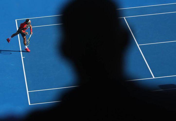 Nadal (foto) venció a Tsonga en partido por el tercer lugar en Abu Dabi, La final la disputarán más tarde Novak Djokovic y David Ferrer. (Agencias)