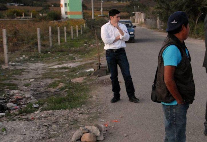 Encuentras cuerpos de tres hombres asesinados en diversas avenidas de San Pedro Garza García, Nuevo León. Imagen de contexto de un lugar donde encontraron cadáveres ejecutados, mientras elementos federales resguardan el lugar. (Archivo/Notimex)