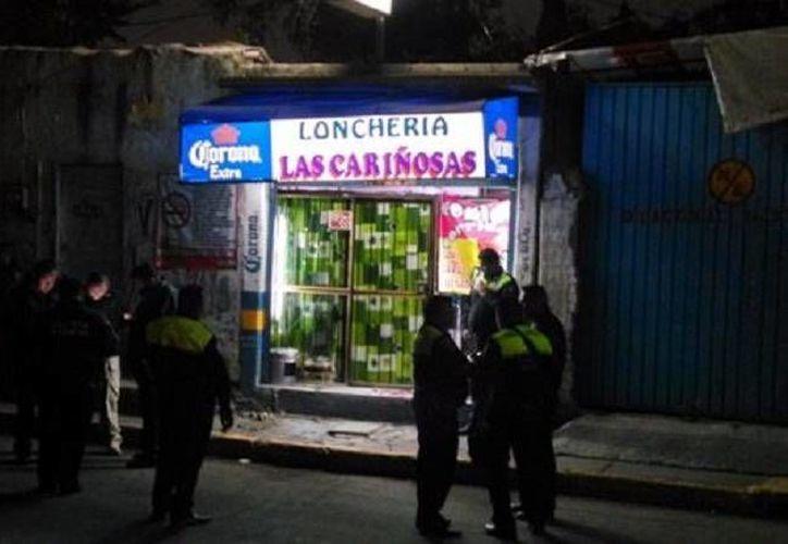 Tras el doble homicidio a balazos en la lonchería Las Cariñosas, en Ecatepec, se presentaron unidades de la Secretaría de Seguridad Ciudadana (SSC) y de la policía municipal. (Milenio)