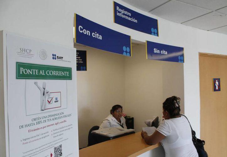 Las empresas deberán cumplir con la contabilidad electrónica  ante el SAT, a partir del primero de enero. (Israel Leal/SIPSE)