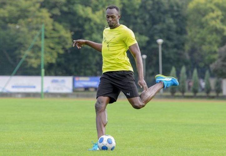 El atleta jamaiquino Usain Bolt aseguró que actualmente se enfoca 100% en el fútbol. (Vanguardia MX)