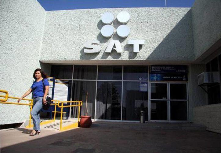 """El SAT señaló que el impacto fiscal del esquema de evasión conocido como """"operación carrusel"""", representa una contingencia de 16 mil millones por concepto del Impuesto al Valor Agregado (IVA). En la imagen, el edificio del organismo en la ciudad de Mérida, Yucatán. (Archivo/SIPSE)"""