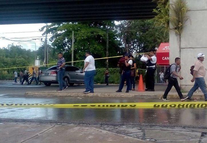 El reporte de una persona ejecutada activó el Código Rojo esta tarde en Puerto Morelos. (Éric Galindo/SIPSE)