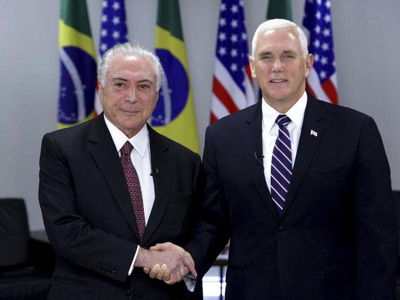 Brazil's President Michel Temer, left, greets U.S. Vice President Mike Pence at Planalto Palace, in Brasilia, Brazil.