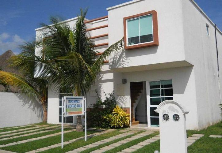 Los profesionales inmobiliarios esperan tener un buen 2015 gracias a la nueva ley que rige sus actividades. (Redacción/SIPSE)