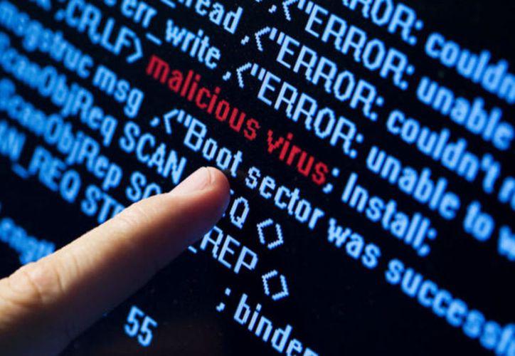 """el mensaje de los ciberdelincuentes en la pantalla principal de este nuevo virus es claro: """"Envía un e-mail a (dirección). (Contexto)"""