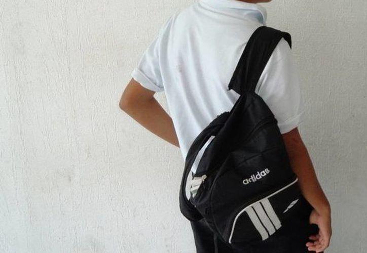 Uno de los menores de edad detenidos. (Juan Palma/SIPSE)