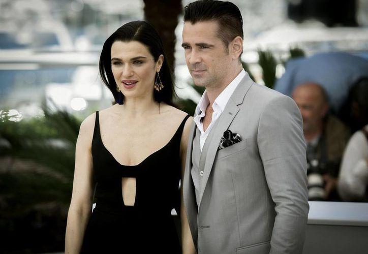 El actor irlandés Colin Farrell interpretará a un mago, en el nuevo filme de Harry Potter, en la imagen Rachel Weisz y Farrell durante el festival de cine en Cannes. (Notimex)