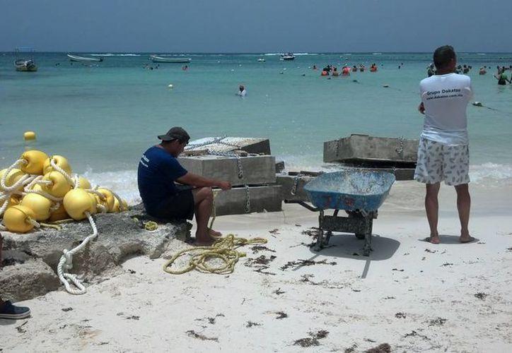Los naúticos acusan que las obras de emboyado dañan el ecosistema marino. (Sara Cauich/SIPSE)