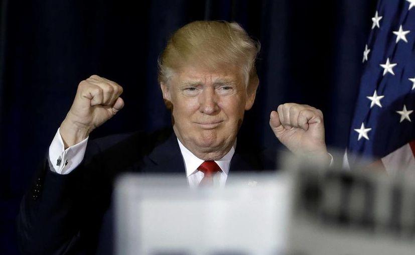 A pesar de lo ajustado de la campaña en los sondeos nacionales, Trump sigue teniendo una senda complicada hacia la victoria. (AP/Chris O'Meara)