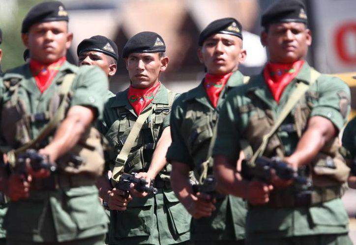 Las Milicias Obreras forman parte de las Milicias Bolivarianas, creadas hace ocho años por el recientemente fallecido Hugo Chávez. (Archivo/EFE)