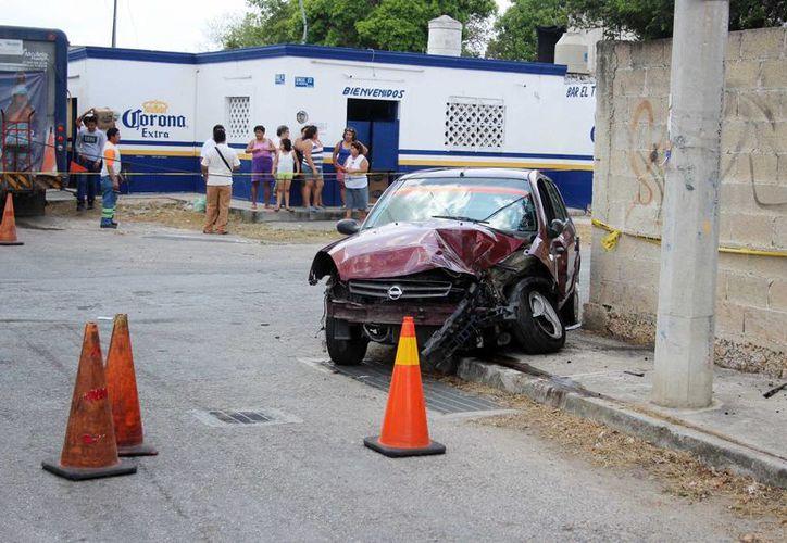 Hasta este martes el camionero y el automovilista implicados en un choque fatal en la colonia Nueva Chichén Itzá permanecían detenidos en la Fiscalía. (Pallota/SIPSE)