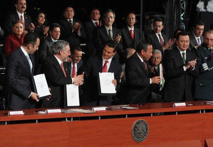 El presidente Enrique Peña Nieto encabezó el evento de la entrada en vigor del Nuevo Sistema de Justicia Penal en todo el territorio nacional. (Notimex)