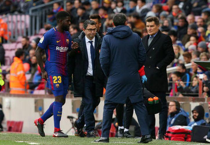 Samuel Umtiti se lesionó durante el partido ante el Celta de Vigo. (Reuters )