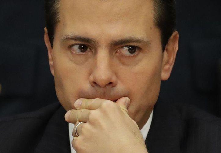 Peña Nieto tiene agendada una reunión en Washington con el presidente Trump este 31 de enero. (AP/Archivo)