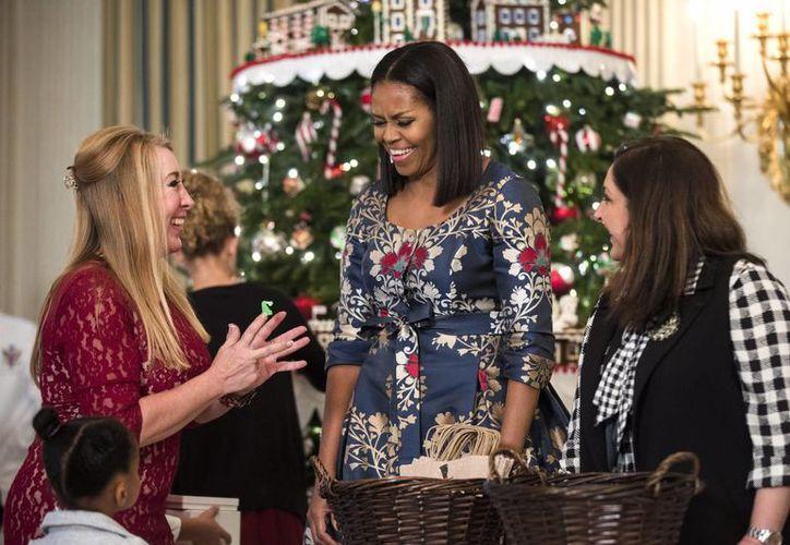 La primera dama Michelle Obama invita a todos los estadounidenses a conocer la Casa Blanca. (EFE)