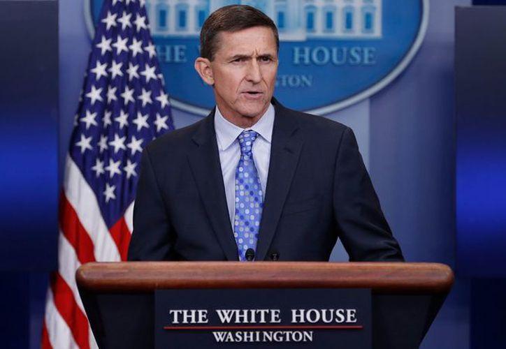 Flynn admitió que ocultó información sobre lo que habló con emisarios del gobierno del presidente ruso, Vladimir Putin. (Foto: Chicago Tribune)