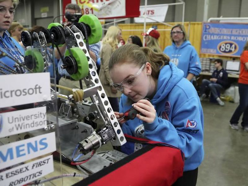 Valerie Alexander works on the team's robot at the FIRST Championship in Detroit. (AP)
