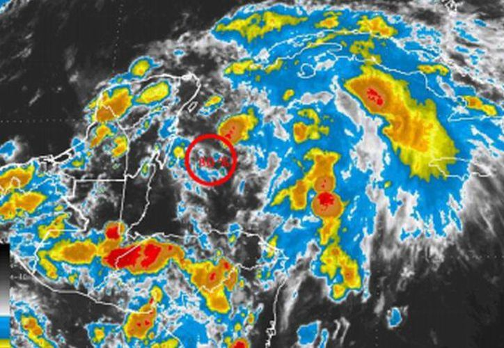 El sistema se localizaba en las primeras horas del domingo a unos 215 km al sureste de Playa del Carmen. (Imagen de Conagua)