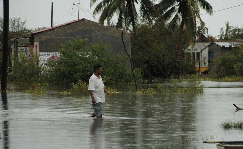 Las partes bajas de tres municipios fueron las más afectadas. (Notimex)