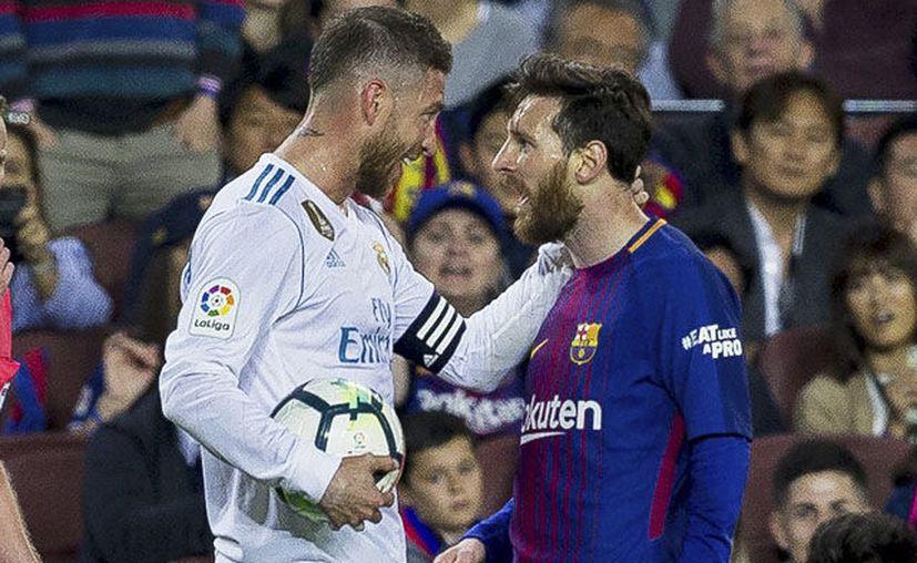 El Real Madrid y el Barcelona se enfrentarán en tres fechas este año. (AFP)