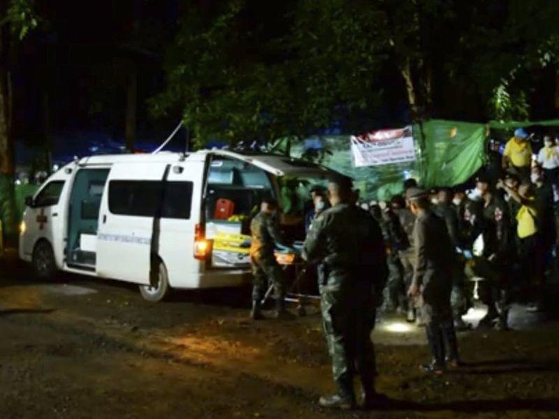 Thai rescue team members walk inside a cave, in Mae sai, chiang Rai province, northern thailand. (AP)