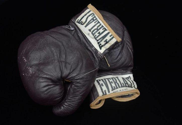 En el 'Combate del Siglo' contra Joe Frazier, Muhammad Alí obtuvo su primer título mundial. (EFE/Archivo)