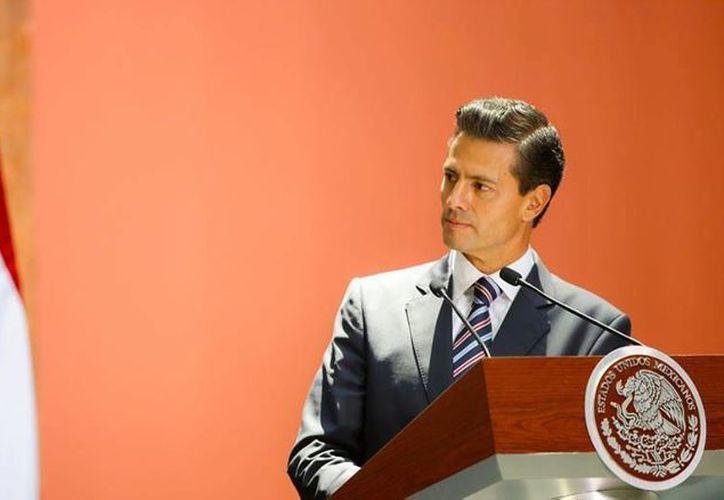 La tesis fue defendida en 1991 y con ella el presidente obtuvo el grado de licenciado en derecho. (facebook.com/EnriquePN)