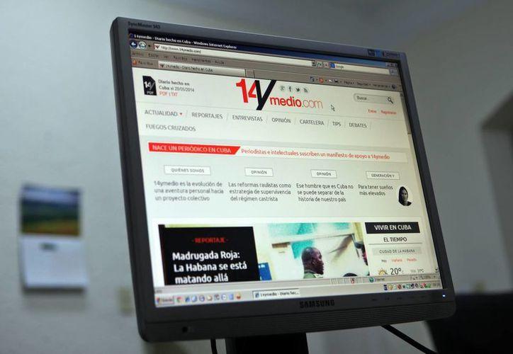 """Vista de la pantalla de una computadora en La Habana, Cuba, donde se observa el diario digital independiente """"14ymedio"""", lanzado este martes por la bloguera opositora cubana Yoani Sánchez. (EFE)"""