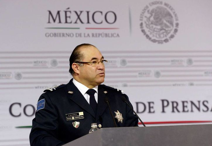 Familiares de los policías federales arrestados por su presunta implicación en la fuga de 'El Chapo' Guzmán le pidieron a Enrique Galindo, jefe de la Policía Federal, que haya seguridad para sus parientes. (Notimex)