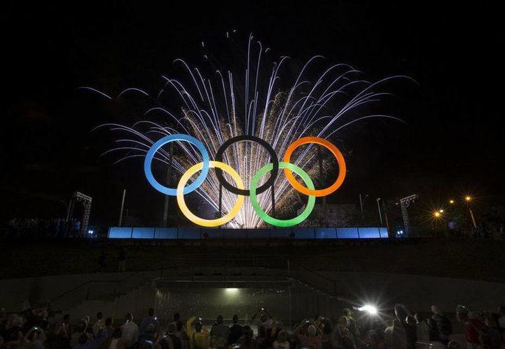 A menos de un año de que los Juegos Olímpicos de Río de Janeiro 2016 comiencen, el gobierno de Brasil anunció que no se les pedirá visa a los extranjeros que ingresen al país, sin embargo, esto no aplica para turistas de  Estados Unidos, Japón y China. (Archivo AP)