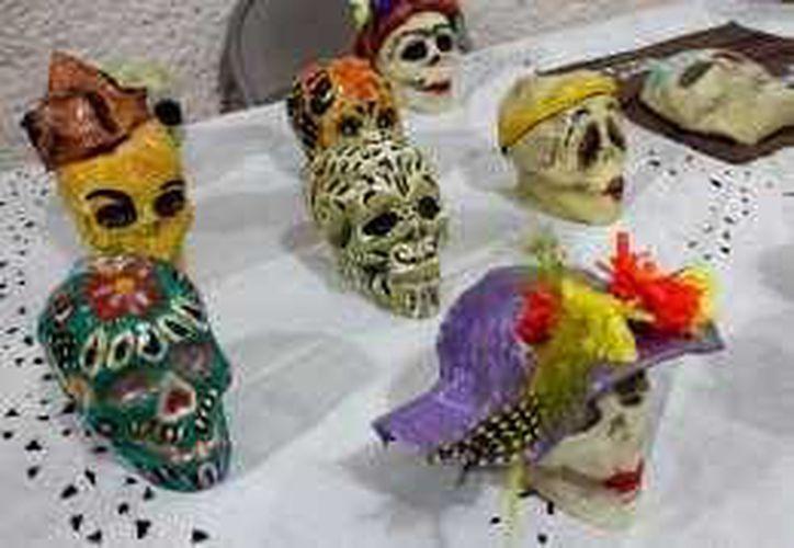 La tradición maya del Día de Muertos busca que sea seguida por los jóvenes. (Foto/Notimex)