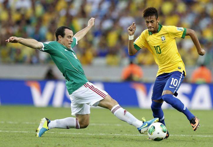 Neymar será pieza clave de Brasil en el Mundial, como lo fue en la Copa Confederaciones. (Agencias)