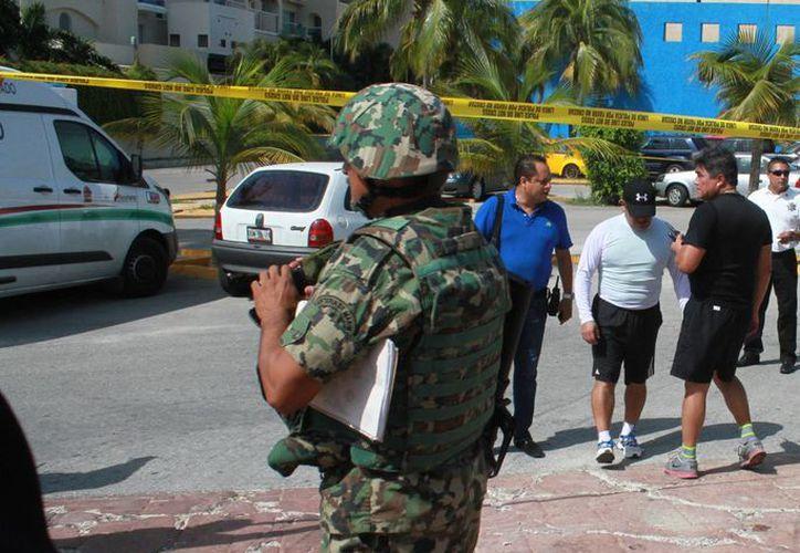 Los hechos se registraron en el estacionamiento del Teatro de Cancún. (Sergio Orozco/SIPSE)